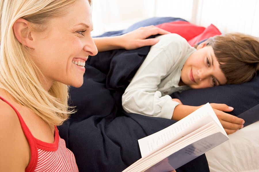 Mother reading bedtime story to child